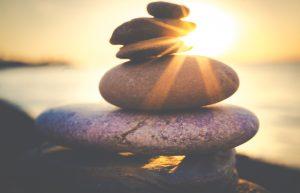balancing stones on the beach